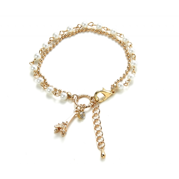 Gold tone eiffel tower charm bracelet with faux pearls
